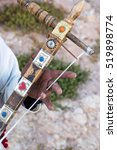 Small photo of Africa,North Africa,Morocco, Ouarzazate, Ait Benhaddou. Man playing Ribab, Moroccan single stringed instrument played with bow.