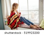 Young Woman In Plaid With Cup...