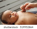 african newborn baby holding... | Shutterstock . vector #519952864