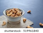 roasted salted cashew nuts in... | Shutterstock . vector #519961840