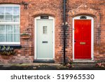 Red And White Doors With Brick...
