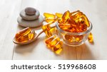 fish oil capsules on wooden... | Shutterstock . vector #519968608