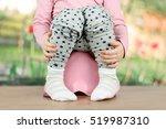 children's legs hanging down... | Shutterstock . vector #519987310