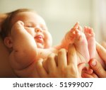 little adorable baby touching... | Shutterstock . vector #51999007