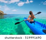 beautiful young woman kayaking... | Shutterstock . vector #519991690
