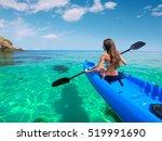 beautiful young woman kayaking... | Shutterstock . vector #519991690