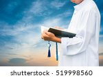 muslim child reading a book on... | Shutterstock . vector #519998560