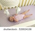 Infant Baby In Purple Crib Wit...
