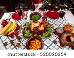 christmas dinner by candlelight ... | Shutterstock . vector #520030354