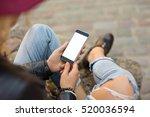 woman using blank screen phone    Shutterstock . vector #520036594