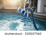 man cleaning swimming pool with ... | Shutterstock . vector #520037560