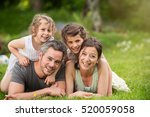 happy family in a park  daddy ... | Shutterstock . vector #520059058