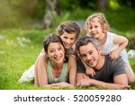 cheerful family in a park  dad  ... | Shutterstock . vector #520059280