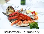 seafood lobster dinner on table ... | Shutterstock . vector #520063279