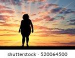 fat woman standing on sunset...   Shutterstock . vector #520064500