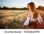 beautiful carefree woman in... | Shutterstock . vector #520066594
