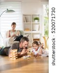 cheerful family at home  daddy... | Shutterstock . vector #520071730