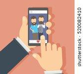 men on the screen. hand holding ... | Shutterstock .eps vector #520082410