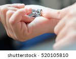 woman cutting nails | Shutterstock . vector #520105810