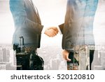 businessmen shaking hands on... | Shutterstock . vector #520120810