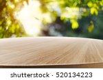 empty wooden table with garden... | Shutterstock . vector #520134223