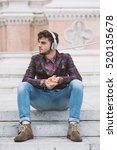young man portrait listening to ... | Shutterstock . vector #520135678