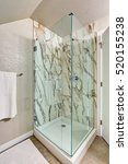 Small photo of Photo of attic bathroom with an alcove shower, marble tile wall trim and glass door. Northwest, USA