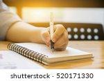 left hand student writes...   Shutterstock . vector #520171330