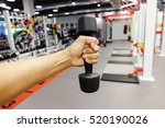 hands holding dumbbells in... | Shutterstock . vector #520190026