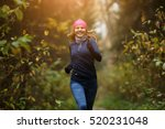 Happy Woman Athlete Jogging In...