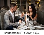couple with champange glasses... | Shutterstock . vector #520247113