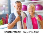 senior couple exercising in gym  | Shutterstock . vector #520248550