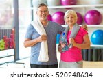 senior couple exercising in gym  | Shutterstock . vector #520248634