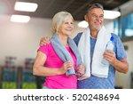 senior couple exercising in gym  | Shutterstock . vector #520248694