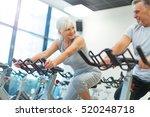 senior couple exercising in gym  | Shutterstock . vector #520248718