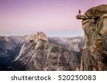 a male hiker standing on an... | Shutterstock . vector #520250083