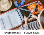 woman packing a luggage on... | Shutterstock . vector #520255528