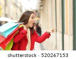 amazed shopper opening mouth... | Shutterstock . vector #520267153