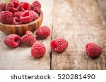fresh raspberries in wooden... | Shutterstock . vector #520281490