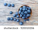 Blueberries In Wooden Bowls On...