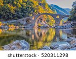 In Autumn Old Stone Bridge Nea...