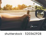 man holding beer bottle while... | Shutterstock . vector #520362928