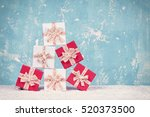christmas gift boxes on blue... | Shutterstock . vector #520373500
