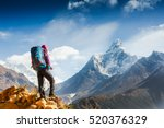 hiking in himalaya mountains.... | Shutterstock . vector #520376329