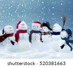 .many Snowmen Standing In...