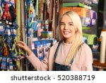Stock photo pretty young woman selecting lead in pet shop 520388719
