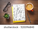 notebook with drawings and cup... | Shutterstock . vector #520396840