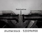 Small photo of Conclusion typed words on a Vintage Typewriter.