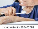 asian elderly woman with a... | Shutterstock . vector #520409884