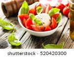 caprese salad with mozzarella... | Shutterstock . vector #520420300